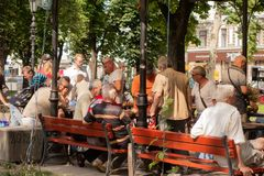 Odessa. Ukraine. 2018.07.26. Elderly people play chess in the park. Odessa. Ukraine. 2018.07.26 Elderly people play chess in the park Mach people stock image