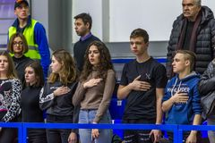 Odessa, Ukraine - Febr 16, 2019: Fans of basketball team and spectators in stands emotionally support their team during intense. Play. Fan club. Visitors fill stock photography