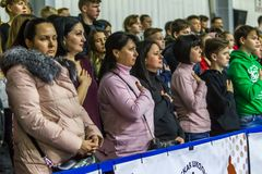 Odessa, Ukraine - Febr 16, 2019: Fans of basketball team and spectators in stands emotionally support their team during intense. Play. Fan club. Visitors fill royalty free stock image