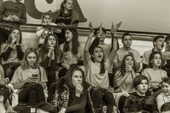 Odessa, Ukraine - Febr 16, 2019: Fans of basketball team and spectators in stands emotionally support their team during intense. Play. Fan club. Visitors fill royalty free stock photo