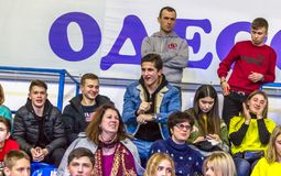 Odessa, Ukraine - Febr 16, 2019: Fans of basketball team and spectators in stands emotionally support their team during intense. Play. Fan club. Visitors fill stock image
