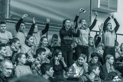 Odessa, Ukraine - Febr 16, 2019: Fans of basketball team and spectators in stands emotionally support their team during intense. Play. Fan club. Visitors fill stock photos