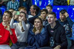 Odessa, Ukraine - Febr 16, 2019: Fans of basketball team and spectators in stands emotionally support their team during intense. Play. Fan club. Visitors fill royalty free stock photos