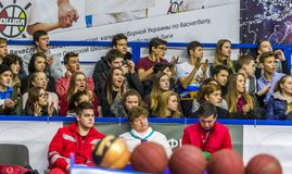 Odessa, Ukraine - Febr 16, 2019: Fans of basketball team and spectators in stands emotionally support their team during intense. Play. Fan club. Visitors fill royalty free stock photography
