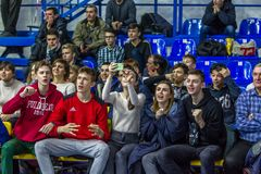 Odessa, Ukraine - Febr 16, 2019: Fans of basketball team and spectators in stands emotionally support their team during intense. Play. Fan club. Visitors fill stock images