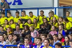 Odessa, Ukraine - Febr 16, 2019: Fans of basketball team and spectators in stands emotionally support their team during intense. Play. Fan club. Visitors fill royalty free stock images