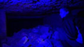 Odessa, Ukraine - 01 FEBRUARY, 2018:  Inside the Odessa Catacombs. Stone column in the underground Odessa catacombs.  Girl walking