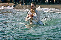 Odessa, Ukraine JANUARY 19, 2012: --:Christian Peopls swimming in ice cold water Black Sea during Epiphany (Holy Baptism) Stock Image