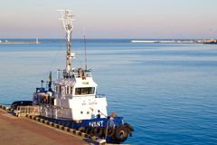 ODESSA, UKRAINE - JANUARY 02, 2017 Tugboat in harbor quayside on Odessa, Ukraine royalty free stock photos