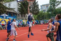 ODESSA, UKRAINE - JULY 28, 2018: Adolescents play basketball during 3x3 streetball championship. Young people play street basketba. Ll on an open city sports stock photo