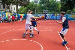 ODESSA, UKRAINE - JULY 28, 2018: Adolescents play basketball during 3x3 streetball championship. Young people play street basketba royalty free stock photos