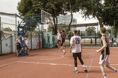 ODESSA, UKRAINE - JULY 28, 2018: Adolescents play basketball during 3x3 streetball championship. Young people play street basketba. Ll on an open city sports royalty free stock photo