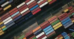 Warehouse with many containers. Odessa, Ukraine - 24 July 2017: Big warehouse with many multicolored containers. There are cranes and trucks. Aerial video stock video
