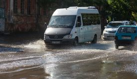 Odessa, Ukraine -3 July 2018: Driving cars on a flooded road during floods caused by rain storms. Cars float on water, flooding st stock photography