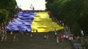 Odessa, Ukraine - 28 June 2014: celebration of the Constitution of Ukraine in Odessa on the Potemkin stairs large national flag Royalty Free Stock Images