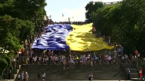 Odessa, Ukraine - 28 June 2014: celebration of the Constitution of Ukraine in Odessa on the Potemkin stairs large national flag Stock Photo