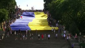 Odessa, Ukraine - 28 June 2014: celebration of the Constitution of Ukraine in Odessa on the Potemkin stairs large national flag Royalty Free Stock Photography