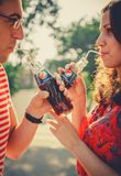 ODESSA, UKRAINE - OCTOBER 15, 2014: Close up of happy young couple outdoors drinking cold Pepsi from glass bottles with straw stock photography