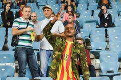 ODESSA, UKRAINE - September 15, 2016: Active fun fans in the sta. Dium during the UEFA Europa League match group stage Zarya Lugansk vs FENERBAHCE Istanbul, 15 royalty free stock photo
