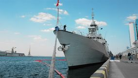 Odessa, Ukraine - September 2019: Canadian warship with a flag on the bow moored in the port by ropes. Unrecognized