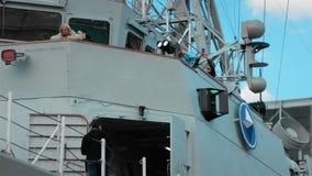 Odessa, Ukraine - September 2019: Civilians on a NATO warship. Beautiful blonde inspects military equipment.