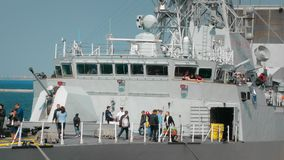 Odessa, Ukraine - September 2019: Civilians visiting a warship of NATO. In the frame of the gun and navigation equipment