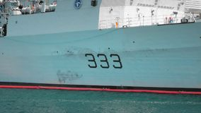 Odessa, Ukraine - September 2019: close-up view of the side of a NATO warship with tail number 333. Unidentified sailors