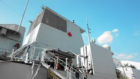 Odessa, Ukraine - September 2019: Coat of arms of the state of Canada on board a NATO warship. Navy men and civilians
