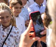 Odessa, Ukraine - September 1, 2018: Happy parents, mothers take royalty free stock photo