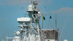 Odessa, Ukraine - September 2019: Lighting, radar equipment and flags on the mast of a NATO ship