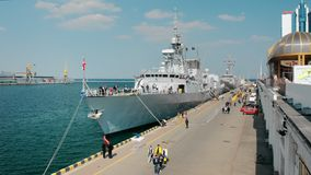 Odessa, Ukraine - September 2019: Nato warships with the Canadian flag on the pier of the port. Excursion for civilians