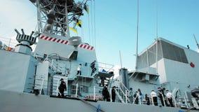 Odessa, Ukraine - September 2019: Navy men on a NATO warship. Against the background of guns and rocket launchers. Radar