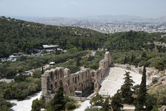 The Odeum theater in Athens and city Royalty Free Stock Photo