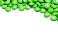 Odgórnego dobra rama zielony czekoladowy cukierek na białym tle Zdjęcie Stock