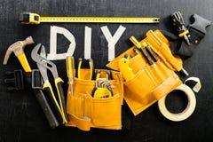 Odgórnego widoku zakończenie narzędzie pasek z budowy słowem i narzędziami Fotografia Stock