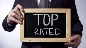 Odgórny sklasyfikowany pisać na blackboard, biznesowy osoby mienia znak, biznesowy pojęcie Obrazy Stock