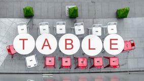 Odgórny widok biali okregów krzesła przy plenerowym z słowem i stół Obrazy Stock