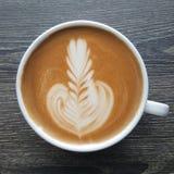 Odgórny widok kubek latte sztuki kawa Zdjęcia Stock