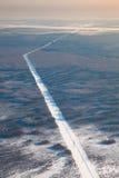Odgórny widok linia energetyczna w zima lesie zdjęcia royalty free