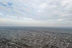 Odgórny widok rolniczy pola zakrywający z śniegiem Obrazy Royalty Free