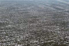 Odgórny widok rolniczy pola zakrywający z śniegiem Obrazy Stock