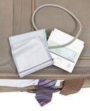Odgórny widok sphygmometer na walizce z krawatami Fotografia Royalty Free
