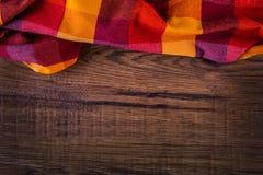 Odgórny widok w kratkę pielucha na drewnianym stole Fotografia Royalty Free