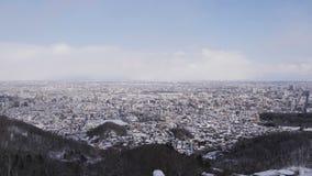 Odgórny widok zakrywający z śniegiem w zimie miasto zbiory
