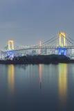 Odiaba Rainbow bridge water reflection at night Stock Photos