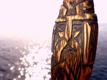 Odin amulet in open waters. Odin wooden amulet in ocean sunshine Royalty Free Stock Photography