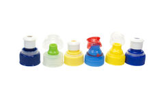 Odizolowywać na biel butelek kolorowe plastikowe nakrętki Zdjęcie Stock