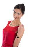 Odizolowywająca dosyć szczęśliwa indyjska kobieta w czerwieni nad białym tłem fotografia royalty free