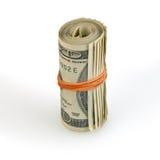 Odizolowywająca na biel rolka pieniądze fotografia royalty free