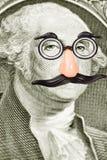 Odkrywczość wąsy na George Washington i szkła Obrazy Stock